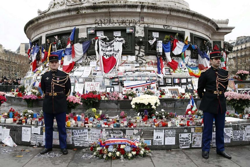 French Republican guards stand during a ceremony to pay tribute to the victims of terrorist attacks in France on Jan 10, 2016.