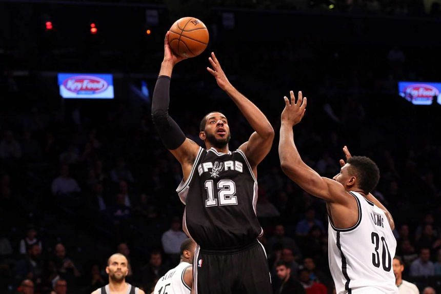San Antonio Spurs forward LaMarcus Aldridge (12) shoots over Brooklyn Nets forward Thaddeus Young (30) at Barclays Centre.