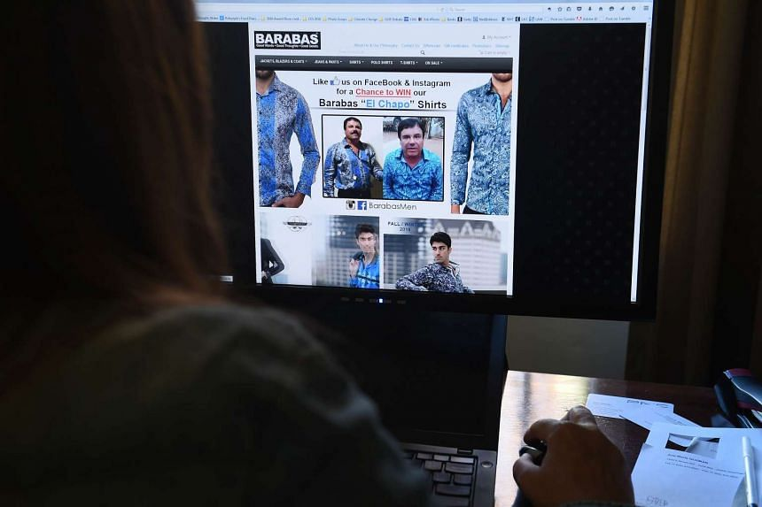 A woman looks at the homepage of clothing house Barabas, which features a photo of Mexican drug lord Joaquin Guzman Loera.