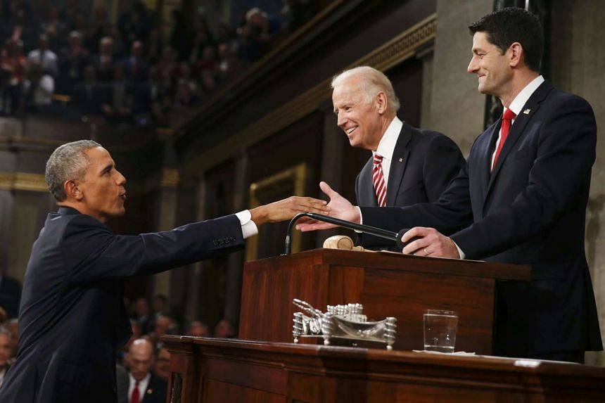 US President Barack Obama (left) is welcomed by Vice-President Joe Biden (centre) and House Speaker Paul Ryan prior to delivering his final State of the Union address.
