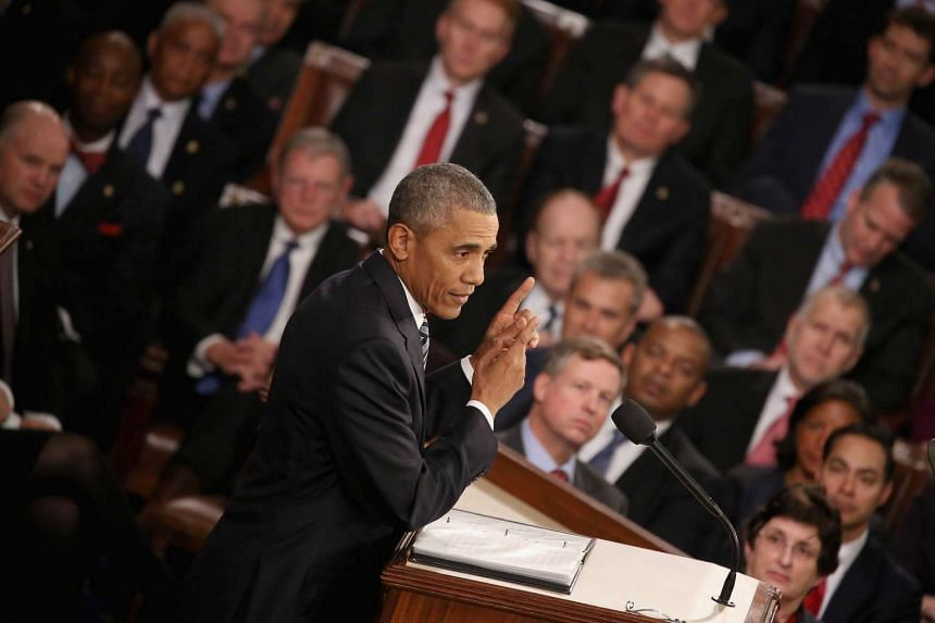 US President Barack Obama delivering the State of the Union speech before members of Congress.