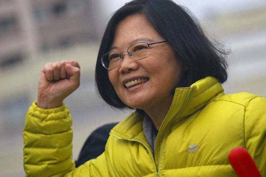 DPP Chairperson and presidential candidate Tsai Ing-wen reacts towards supporters during a campaign rally in New Taipei City.