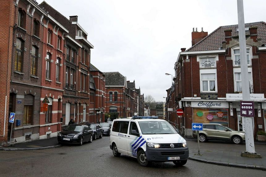 "A Belgian police van is pictured in a street called ""Rue du Fort"" in Charleroi, Belgium, on Jan 13, 2016. A number of the Paris attackers used two apartments and a house in Belgium as possible safe houses in the weeks in leading up to their coordinat"