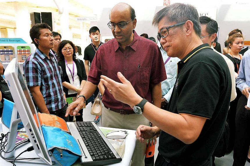Deputy Prime Minister Tharman Shanmugaratnam (centre) at the launch of the SkillsFuture Marketplace, at Westgate mall on Jan 9, 2016.