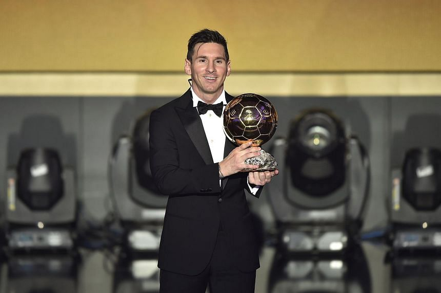 Lionel Messi poses with his trophy after receiving the 2015 Fifa Ballon d'Or award for player of the year.