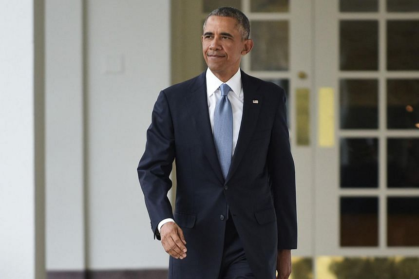 US President Barack Obama walks through the Colonnade from the Oval Office.