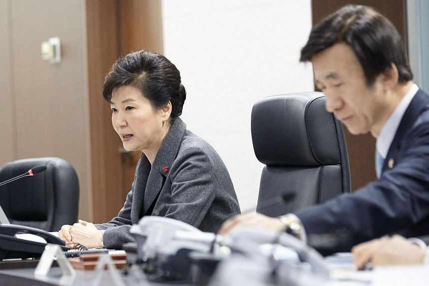 South Korean President Park Geun Hye (left) speaking as Foreign Minister Yun Byung Se listens during an emergency meeting of the National Security Council.