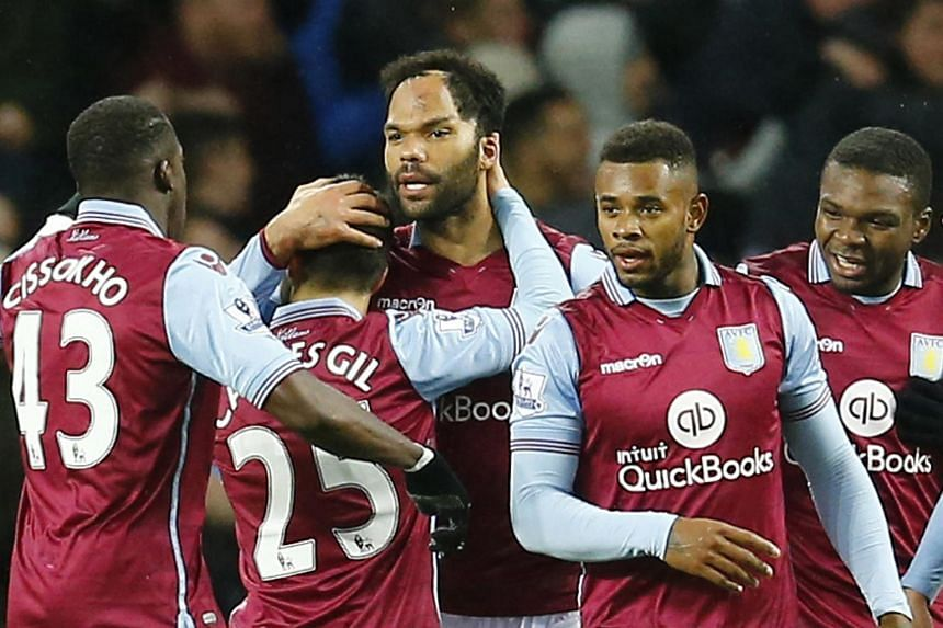 Aston Villa's Joleon Lescott celebrates with teammates after scoring their first goal against Crystal Palace.