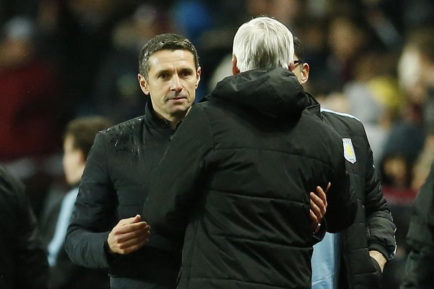 Aston Villa manager Remi Garde (left) with Crystal Palace manager Alan Pardew at the end of the match.