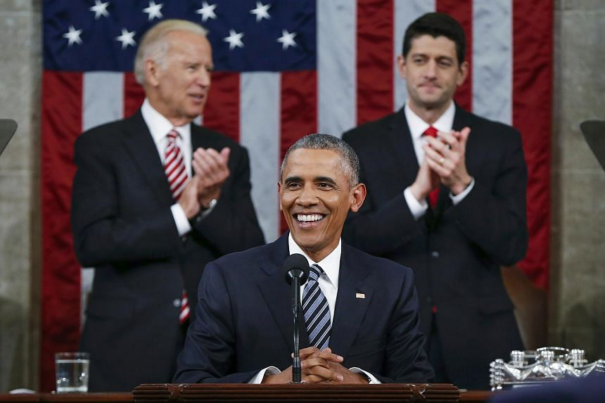 US President Barack Obama (centre) is applauded by House Speaker Paul Ryan and Vice President Joe Biden (left) while delivering his final State of the Union address.