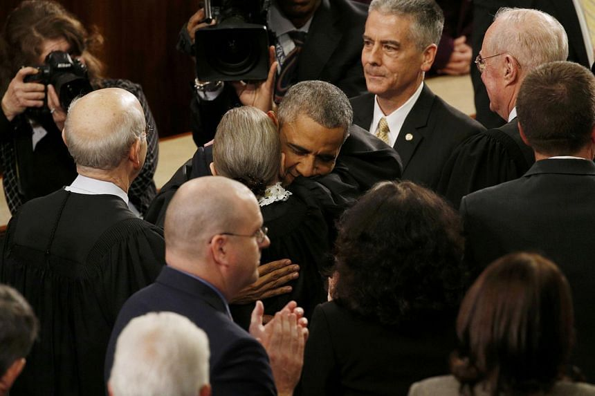 US President Barack Obama hugs Associate Supreme Court Justice Ruth Bader Ginsburg.