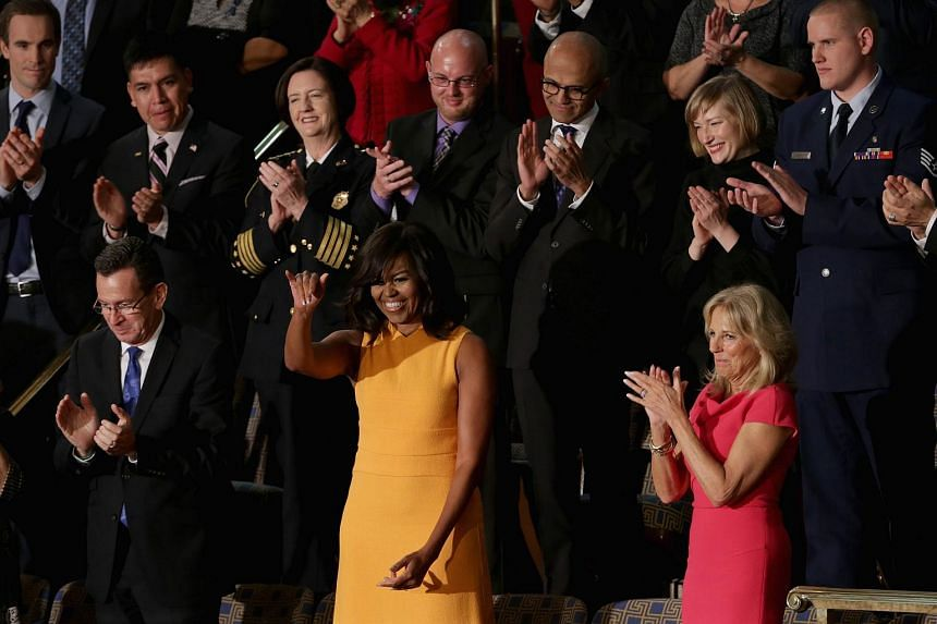First lady Michelle Obama (centre) waves to members of the congress.