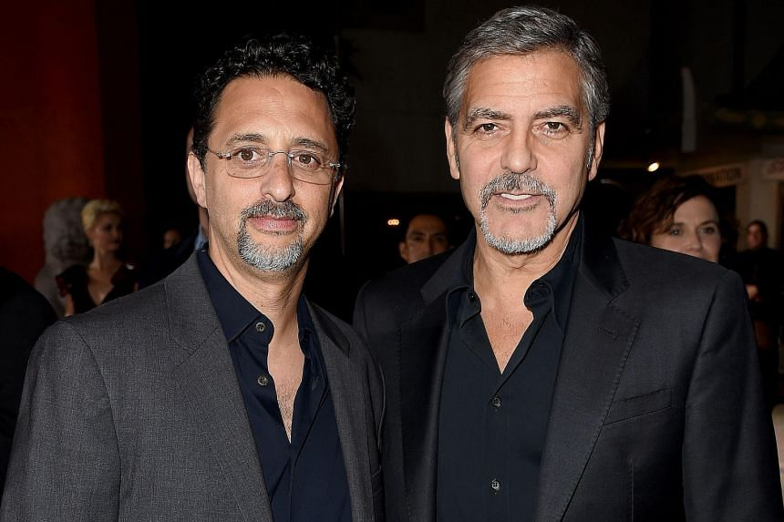 Film producers Grant Heslov (left) and George Clooney developed the story behind Our Brand Is Crisis.