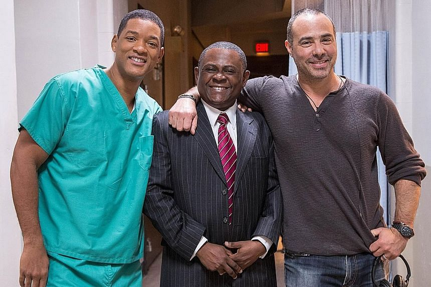 (From left) Actor Will Smith with the real Bennet Omalu whom he portrays in Concussion, and director Peter Landesman. The doctor wants to manage risks in high-impact as well as limited contact sports.
