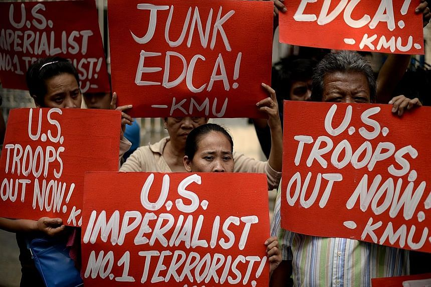 Activists protesting outside the Supreme Court in Manila yesterday against a military accord that the Philippines signed with the US in 2014.