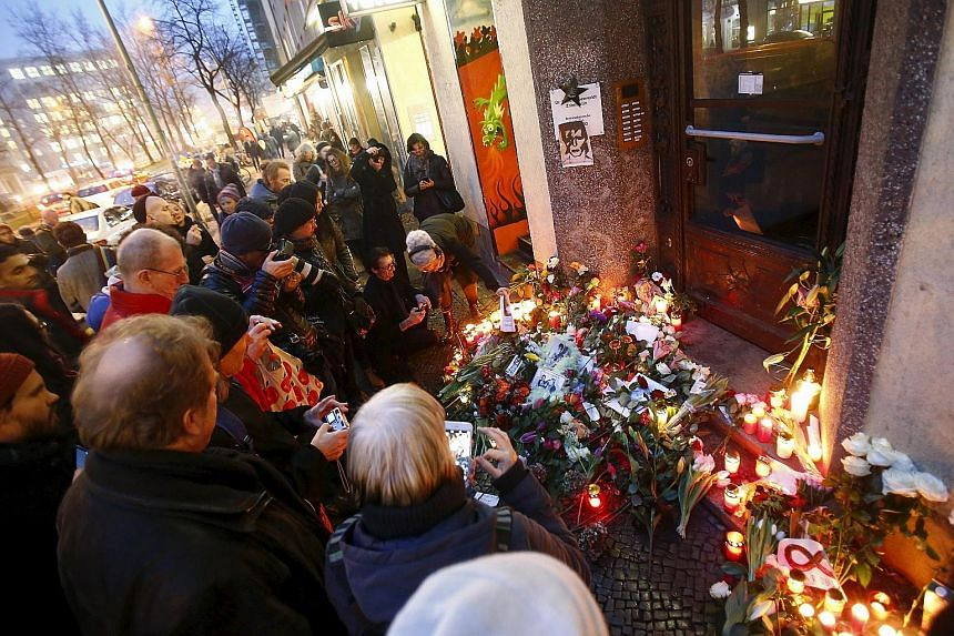 GERMANY: People mourn outside the apartment where Bowie had lived in Berlin.