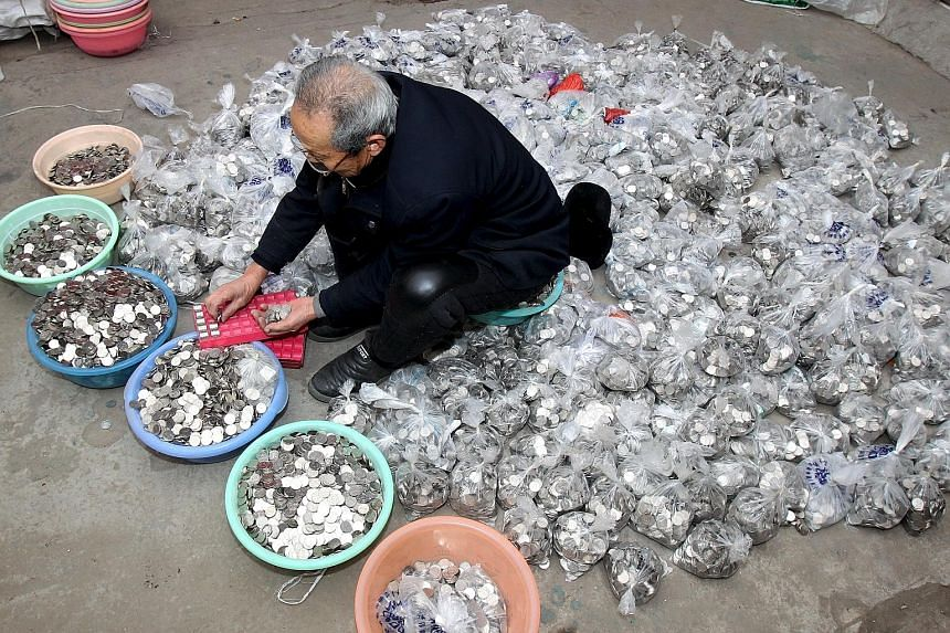 Coins from coin-operated laundry machines being counted at a warehouse in Henan province, China, on Monday. Some observers believe real growth levels in China are much weaker than official data suggest, reinforcing expectations that the government wi