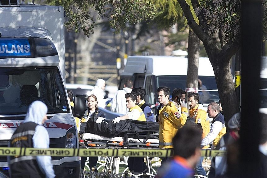 Paramedics removing a body from the scene after a blast triggered by an ISIS suicide bomber near the Blue Mosque in the Sultanahmet district of Istanbul, Turkey, yesterday, killed 10 people, mostly foreigners. It is believed that most of the victims