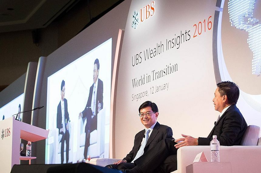 Mr Heng Swee Keat (left) and Mr Edmund Koh during the dialogue at the UBS Wealth Insights conference held at the Raffles City Convention Centre yesterday.