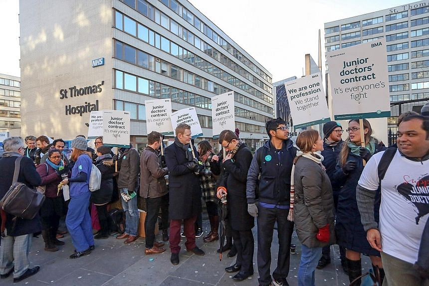 Unhappy over a new government contract, junior doctors at National Health Service hospitals went on strike in London yesterday.