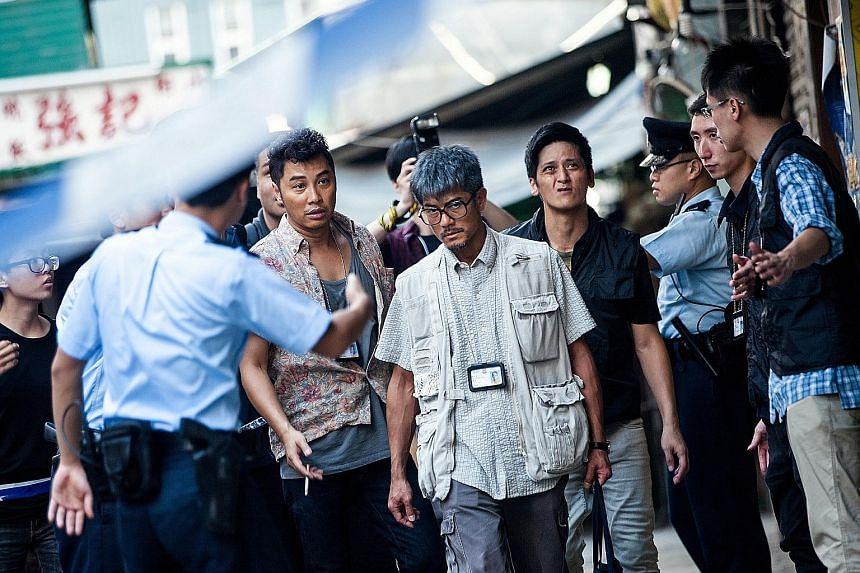 Aaron Kwok (centre) plays quirky Chong Sir with salt-and- pepper hair and a kendama toy.