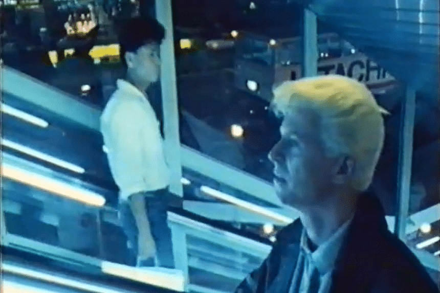 David Bowie on an escalator in Far East Plaza in the film Ricochet.