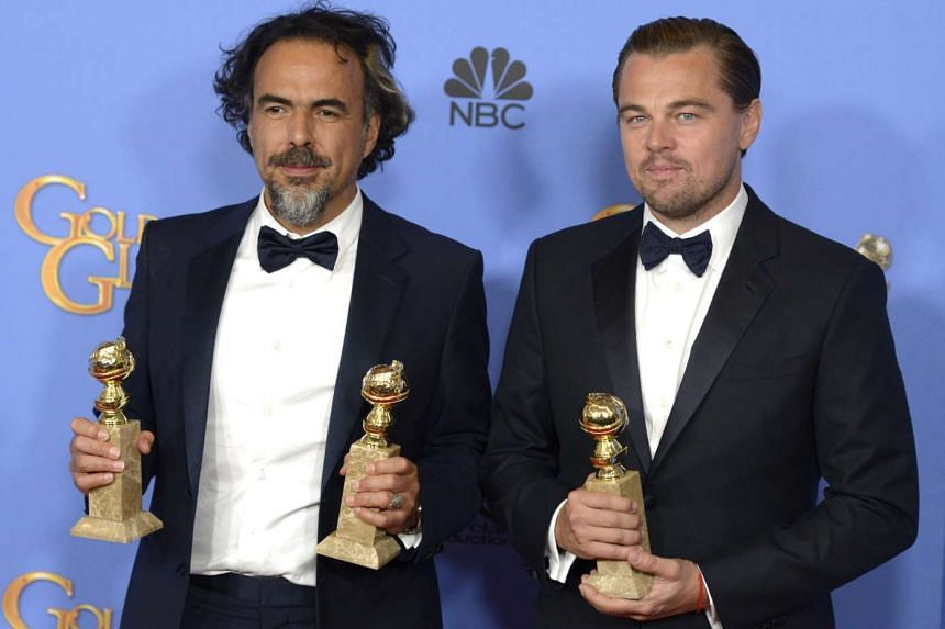 Alejandro Inarritu (left) and Leonardo DiCaprio hold their awards for The Revenant at the 73rd Annual Golden Globe Awards.