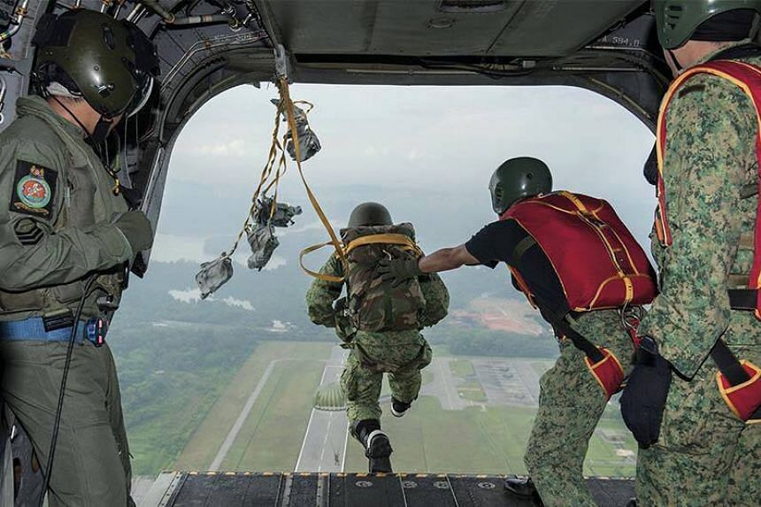 Singapore Armed Forces paratroopers executing their jumps.