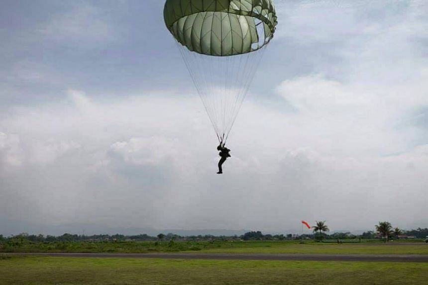 Safe parachuting by a Singapore Armed Forces paratrooper.