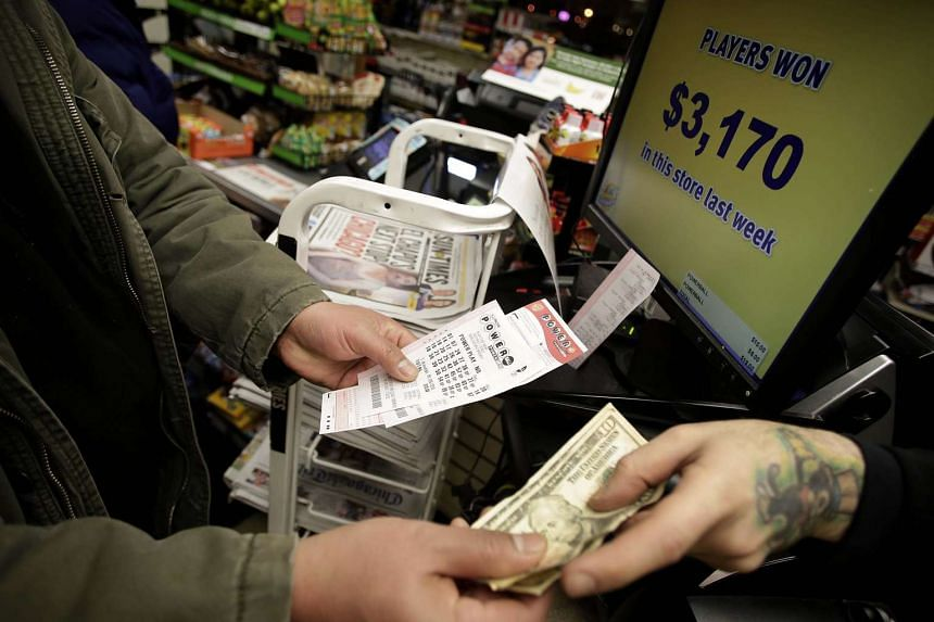 A customer buying Powerball tickets at a 7-Eleven store in Chicago, Illinois.
