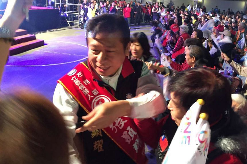 Mr Chang Hsien-yao (above) is facing his toughest test battling DPP's Ms Liu Shih-fang for control of the Zuoying-Nanzih district.