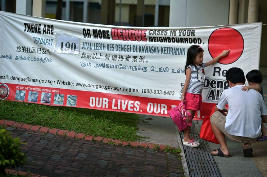 A banner last Friday showing the number of dengue cases at hot spots in Tampines Avenue 4 as of Jan 7. January is traditionally the low season for the viral disease.