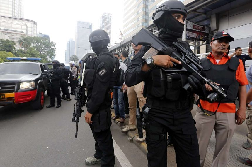 Indonesian security troopers standing guard after a bomb blast in front of a shopping mall in Jakarta on Jan 14, 2016.