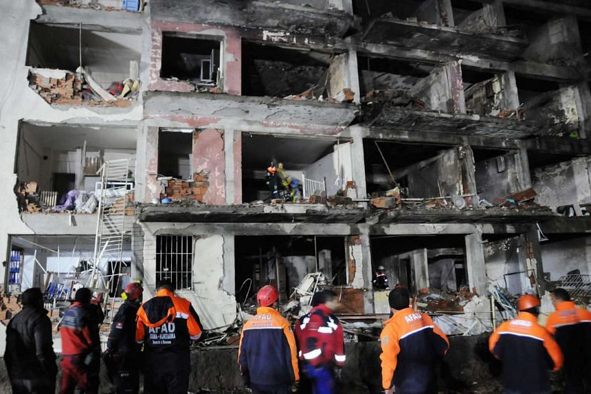 Rescue personnel working at the scene of a bomb blast in Diyarbakir, south-eastern Turkey, on Jan 14, 2016.