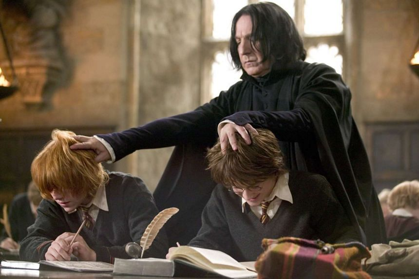 Alan Rickman with Rupert Grint and Daniel Radcliffe in Harry Potter And The Goblet Of Fire.