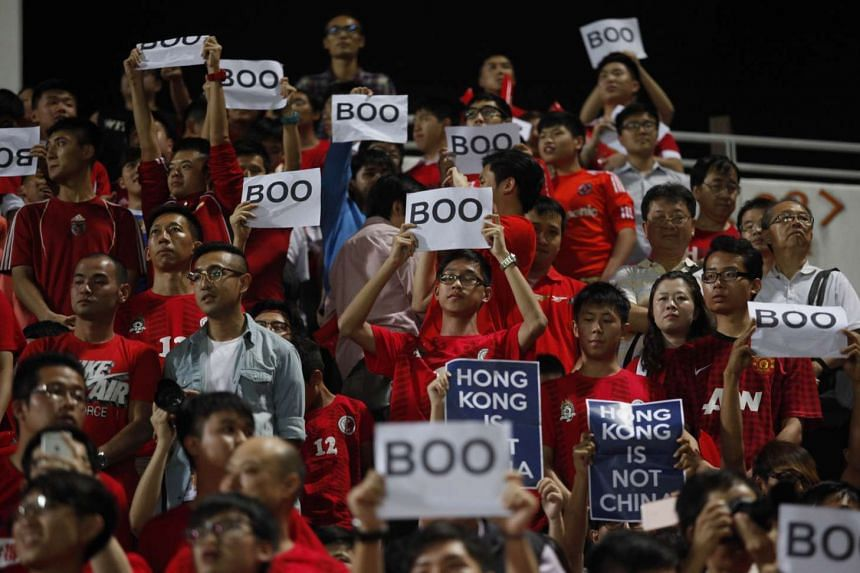 "Hong Kong fans holding up signs that read ""Boo"" while the national anthem was being played."