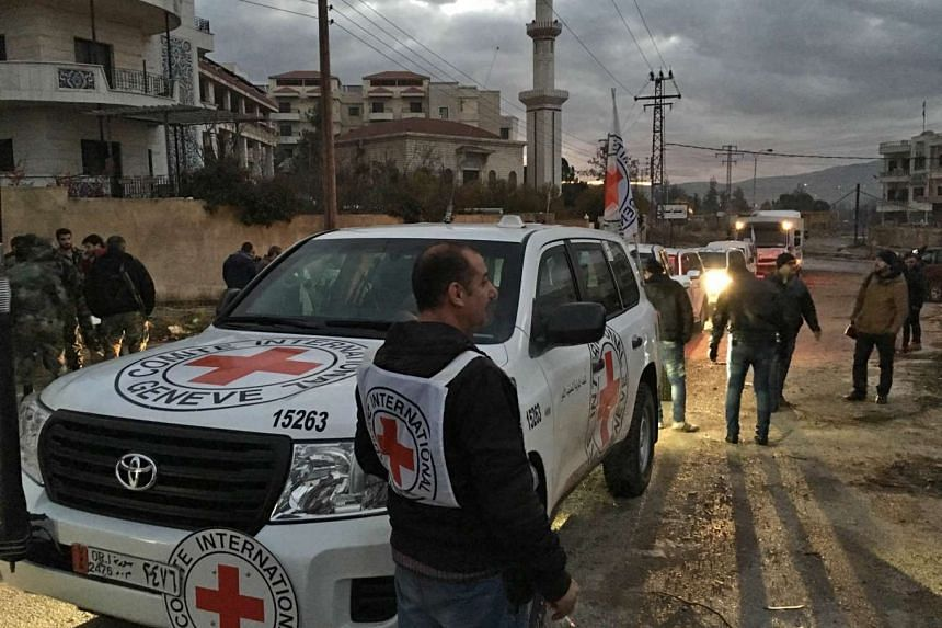 A Jan 11 photo by the International Committee of the Red Cross, showing an aid convoy upon its arrival in Madaya, Syria.