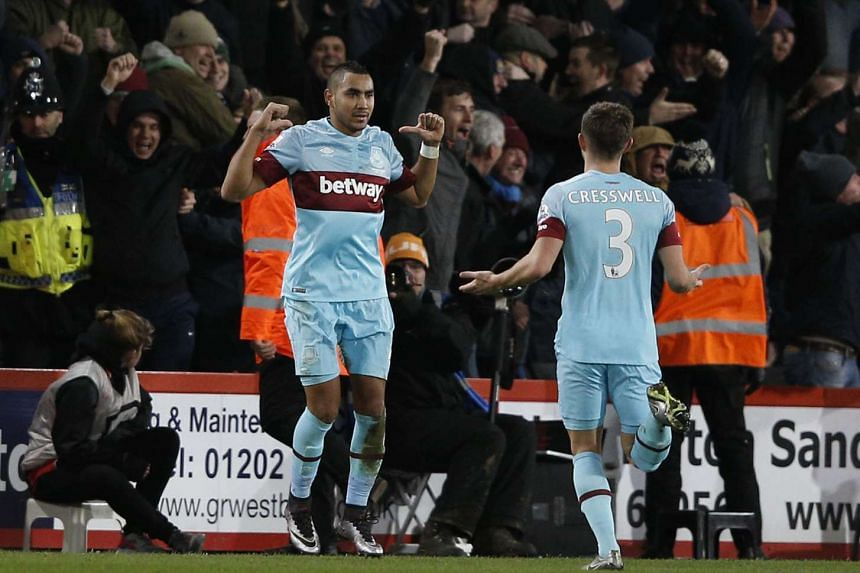 West Ham United's midfielder Dimitri Payet (left) at the football match between Bournemouth and West Ham United in Bournemouth, on Jan 12, 2016.
