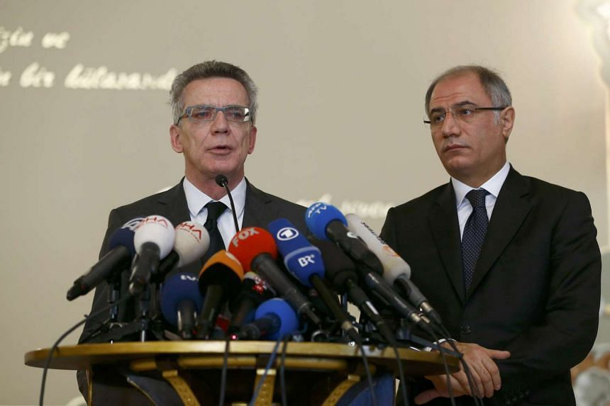 Turkish Interior Minister Efkan Ala (right) and his German counterpart Thomas De Maiziere during a joint news conference in Instanbul on Jan 13, 2016.