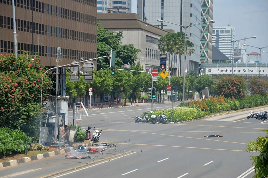 Bodies lie on the street near a damaged police post after a series of blasts hit the Indonesia capital Jakarta on Jan 14, 2016.