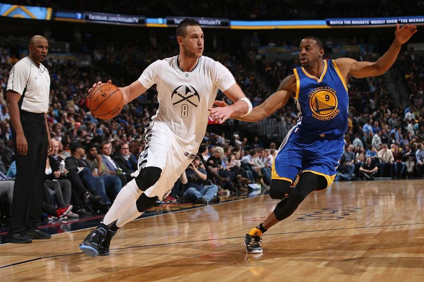 Danilo Gallinari of the Denver Nuggets drives with the ball against Andre Iguodala of the Golden State Warriors.