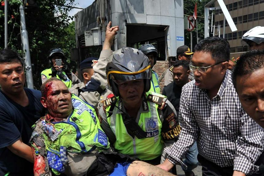An injured Indonesian policeman is evacuated from the site of a bomb blast in Jakarta on Jan 14, 2016.