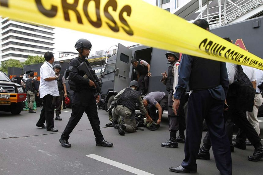 Indonesian special forces officers standing guard at the scene of a bomb blast in Jakarta on Jan 14, 2016.