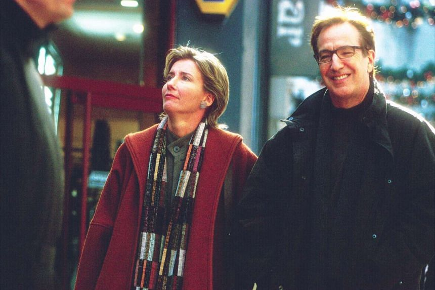 Alan Rickman with Emma Thompson in Love Actually.