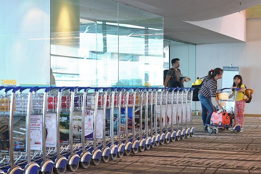 Travellers arriving in Singapore (left). Those who use the Customs@SG app (above) can exit the checkpoint through the Customs Green Channel without having to stop to declare and pay the duty/GST for the goods at the Customs Tax Payment Office.