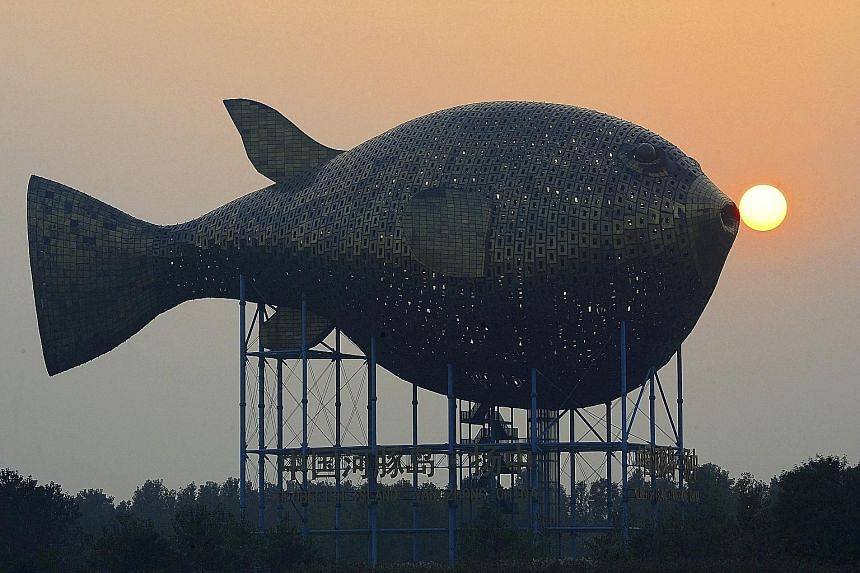 A giant puffer fish, on the banks of a river in Yangzhong county, China's Jiangsu province, is encased in 8,920 copper plates and was built at a cost of around 70 million yuan (S$15 million). Trade data released yesterday showed China's copper import