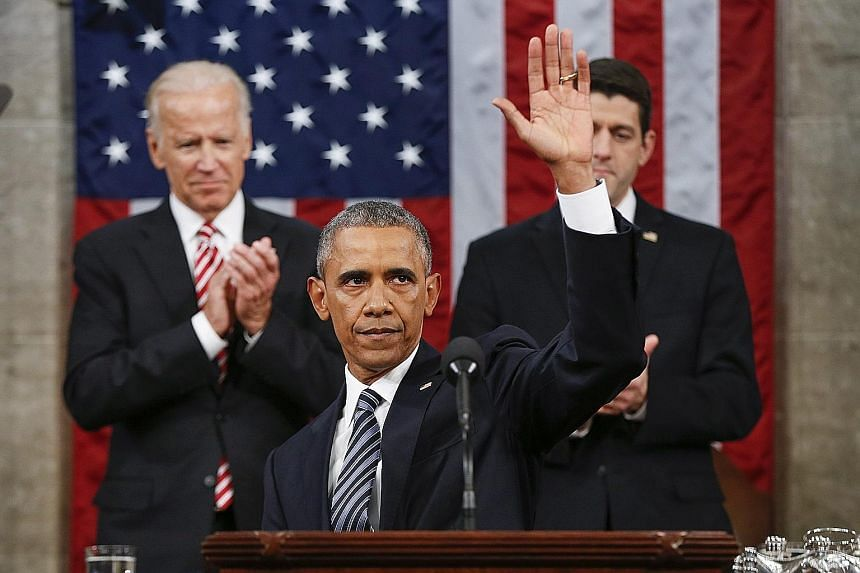 "US President Barack Obama concluding his State of the Union address on Tuesday. Behind him were Vice-President Joe Biden (left) and House Speaker Paul Ryan. In his most forceful call for the US to fix its politics, Mr Obama said ""it's not enough to j"