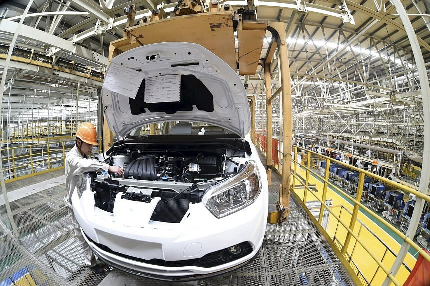 "A production line at Dongfeng Nissan Passenger Vehicle Co's factory in Zhengzhou, Henan province. Nissan, the biggest Japanese carmaker in China, in November predicted ""healthy growth"" for vehicle sales this year."