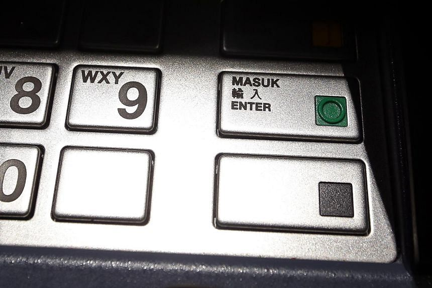 The ATMs are enhanced with user-friendly functions for those who have visual disabilities, such as Braille instructions (left, top) and audio guidance. The user simply has to plug his or her earphones into the ATM's audiojack (left, bottom) to activa