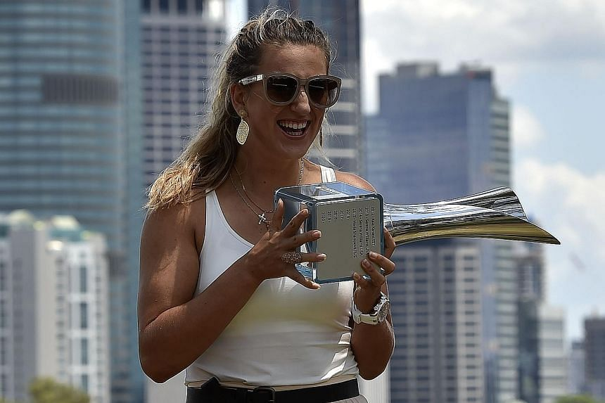 Victoria Azarenka showing off her Brisbane International trophy on Monday. After struggling with injury, depression and heartbreak over the last two years, the Belarusian claimed her first title since 2013 on Sunday. The win put her back in the top 2